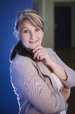 Mature woman in the hall Royalty Free Stock Photography