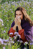Mature woman with handkerchief in a flower field Royalty Free Stock Photos
