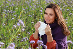 Mature woman with handkerchief in a flower field Royalty Free Stock Images