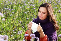 Mature woman with handkerchief in a flower field Stock Photos