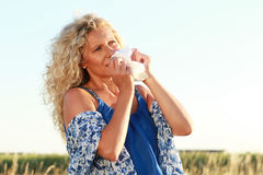 Mature woman with handkerchief outdoor Royalty Free Stock Image