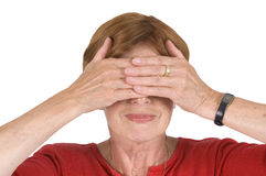 Mature woman hands at the eyes Stock Photography