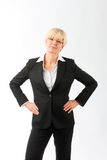 Mature woman with hands on her hips Royalty Free Stock Image