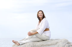 Mature woman happy relaxed outdoor isolated Stock Photos