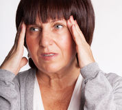 Mature woman has a headache. Royalty Free Stock Photo