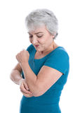 Mature woman has joint pain - isolated on white. Portrait of mature woman has joint pain - isolated on white Stock Images