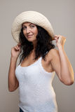 Mature woman in a hat. Mature brunette woman in a beige hat looking like a sailor Royalty Free Stock Photo