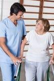 Mature Woman having ambulatory therapy Royalty Free Stock Photos