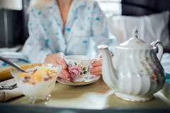 Mature Woman Having Breakfast in Bed Stock Image