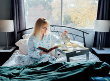 Mature Woman Having Breakfast in Bed Royalty Free Stock Photos