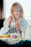Mature Woman Having Breakfast in Bed Stock Images