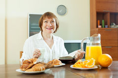 Mature  woman having breakfast Stock Photography