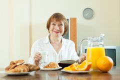 Mature  woman having breakfast Stock Photo