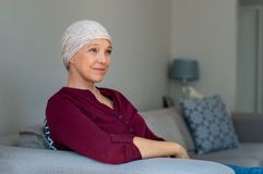 Mature woman having cancer hair loss royalty free stock photo