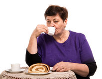 Mature woman having coffee with cake Royalty Free Stock Image