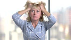 Mature woman having headache. stock video