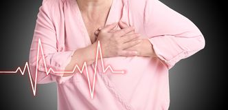 Mature woman having heart attack. On white background royalty free stock photo