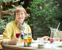 Mature woman having lunch in  restaurant Stock Photography