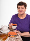 Mature woman having tea Royalty Free Stock Photo