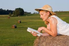 Mature Woman on a haystack Stock Photo