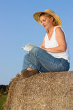 Mature Woman on a haystack Stock Image