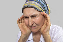 Mature woman with headache Stock Image