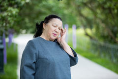 Mature woman with a headache Royalty Free Stock Images