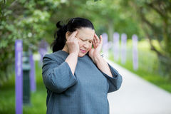Mature woman with a headache Royalty Free Stock Photography