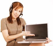Mature woman with headset and notebook Royalty Free Stock Photo
