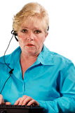 Mature woman headset operator Royalty Free Stock Photo