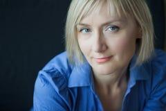 Mature woman headshot studio portrait Royalty Free Stock Image