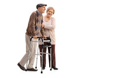 Mature woman helping a mature man with a walker Royalty Free Stock Image