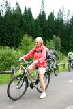 Mature woman on her bike Royalty Free Stock Image