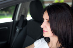 Mature woman in her car Royalty Free Stock Photography