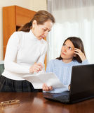 Mature woman and her daughter with notebook Stock Image