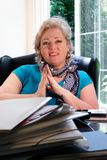 Mature woman at her desk, smiling Royalty Free Stock Photo