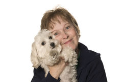 Mature Woman with her puppy. (Maltipoo) on White Background Mixed Breed 1/2 Maltese 1/2 Toy Poodle stock photography