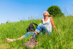 Mature woman at a hiking rest Stock Photo