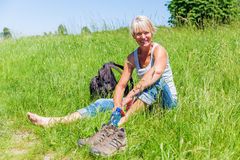Mature woman at a hiking rest Stock Photography