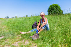 Mature woman at a hiking rest Stock Image