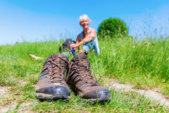 Mature woman at a hiking rest Royalty Free Stock Photography