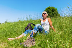 Mature woman at a hiking rest Royalty Free Stock Images