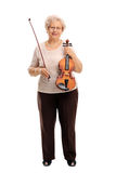 Mature woman holding an acoustic violin Royalty Free Stock Photo