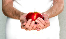 Mature woman holding a beautiful red apple Stock Images