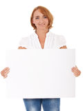 Mature woman holding blank sign Royalty Free Stock Photo