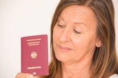 Mature woman holding German passport Royalty Free Stock Image