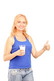 Mature woman holding a glass of milk Stock Images