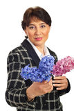 Mature woman holding hyacinth Royalty Free Stock Images