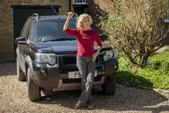 A mature woman holding the keys to her new car Stock Photos