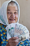 Mature woman holding money Royalty Free Stock Photography
